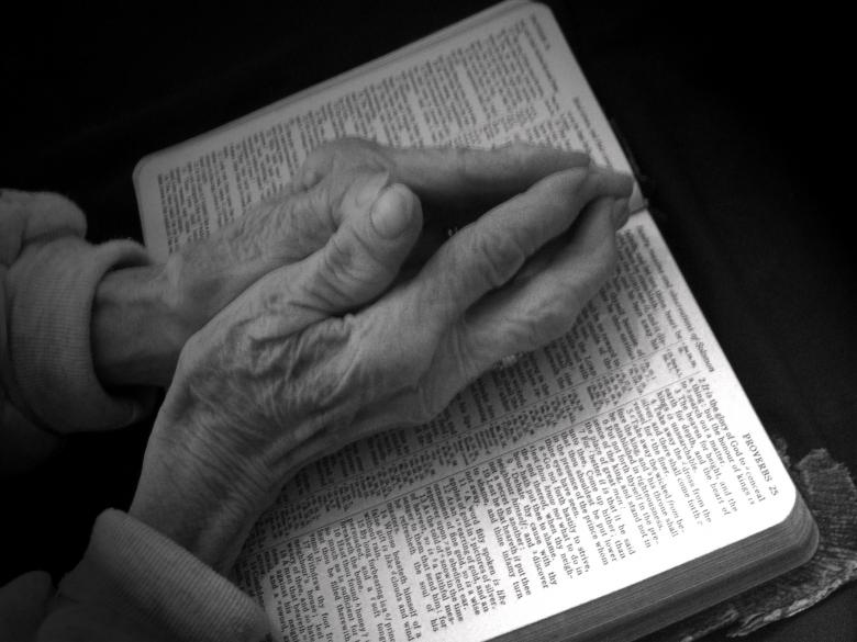 Free Stock Photo of Praying Hands on Bible - Black and White Created by David Hensen