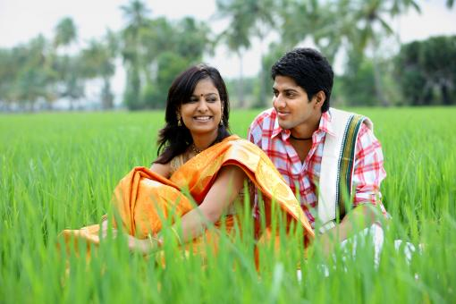 Couple sitting in a paddy field - Free Stock Photo