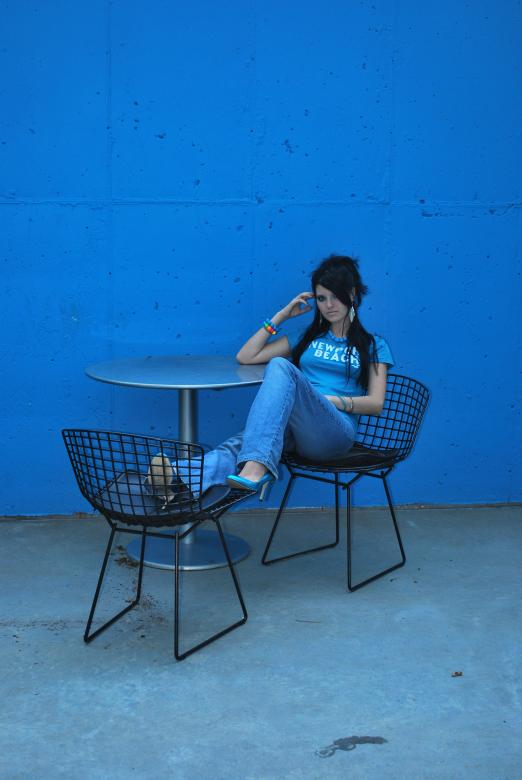 Free Stock Photo of Girl and Blue Wall Created by Bina Sveda