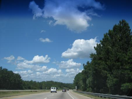 Clouds while driving - Free Stock Photo