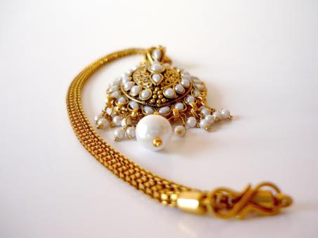 Gold and pearl necklace - Free Stock Photo
