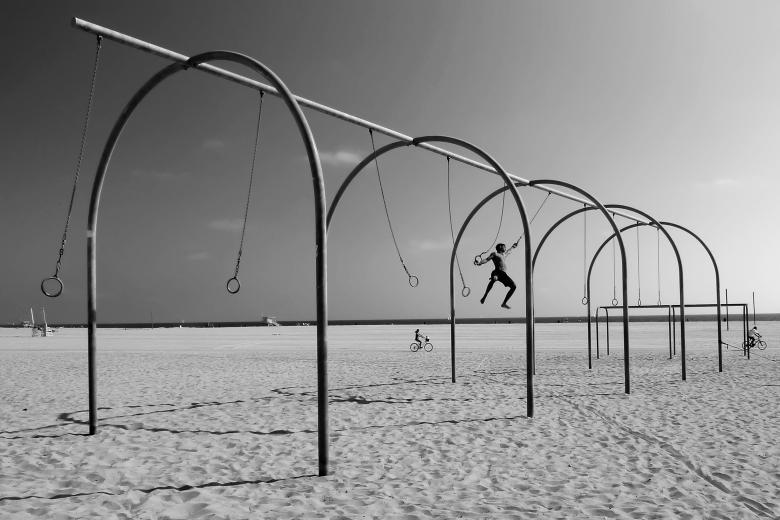 Free Stock Photo of Swinging on Santa Monica Beach Created by Andre Bogaert