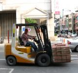 Free Photo - Driving a Forklift