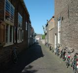 Free Photo - Alley with parked bicycles