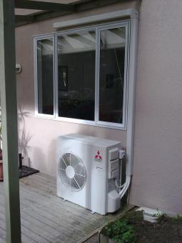 Air conditioner under window - Free Stock Photo