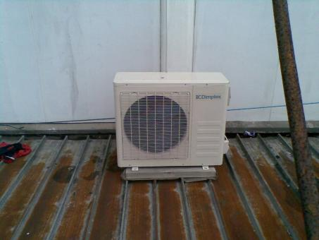 Air conditioner on rusted roof - Free Stock Photo