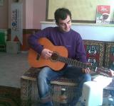 Free Photo - Kerim playing the guitar