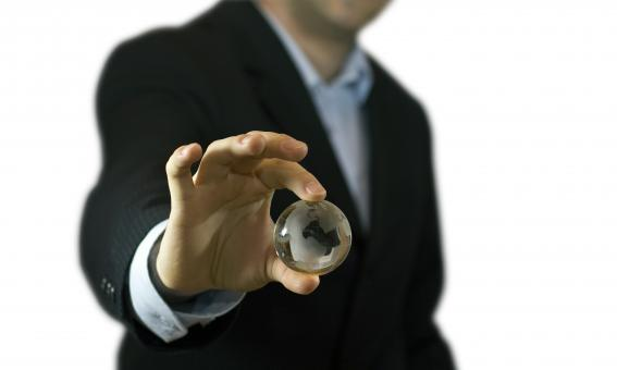 Businessman and crystal globe - Free Stock Photo