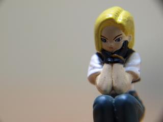 Bored girl, macro toy Free Photo