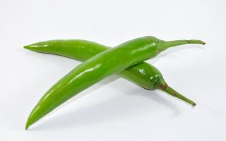Conceptual Green Chillies  Free Photo