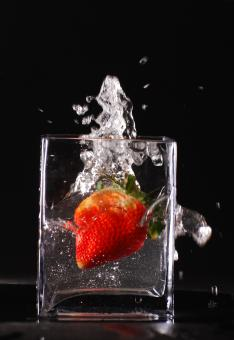 Splashing strawberry - Free Stock Photo