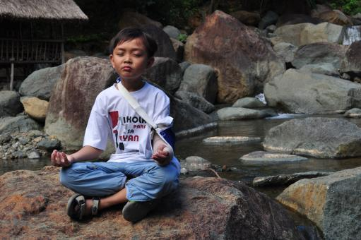 Boy in meditation - Free Stock Photo