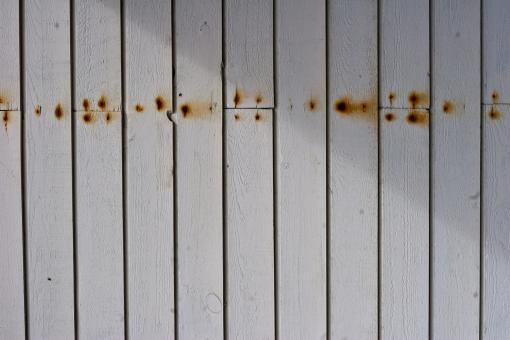 Rusted nails in wood - Free Stock Photo