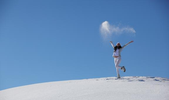 Young happy girl plays with snow - Free Stock Photo