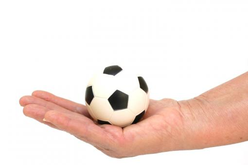 soccer ball in hand - Free Stock Photo