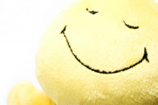 Smiling yellow toy - Free Stock Photo