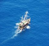 Free Photo - Small ship in the blue waters of Mediter