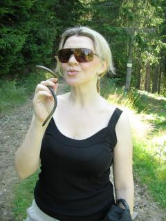 Young woman with snake. Free Photo