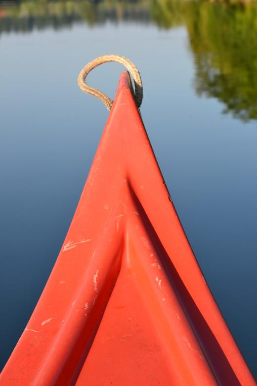 Free Stock Photo of Red Canoe on a river Created by Tilen Hrovatic