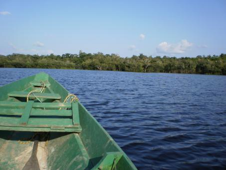 A small boat on amazon river - Free Stock Photo