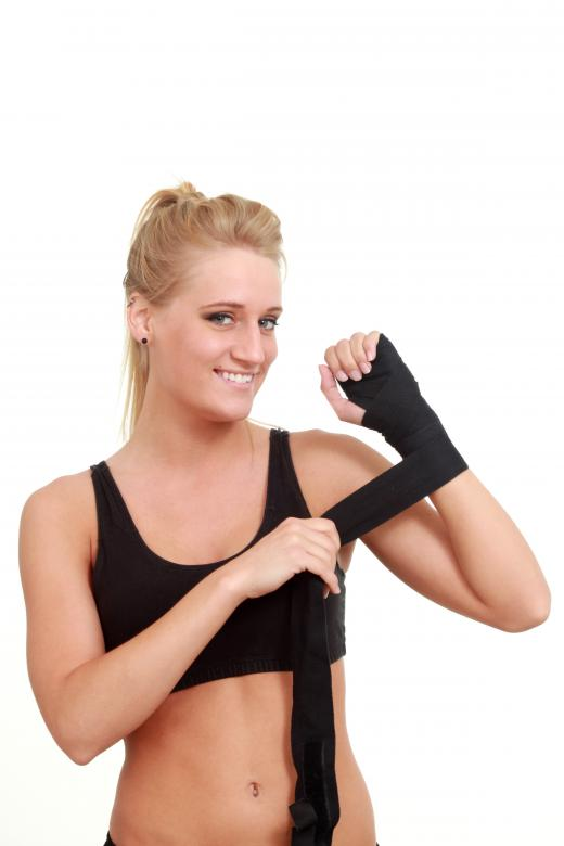 Free Stock Photo of Woman wrapping her hands for a wrestling Created by Val Lawless