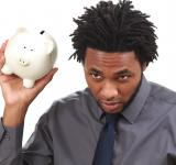 Free Photo - Man with a piggy bank