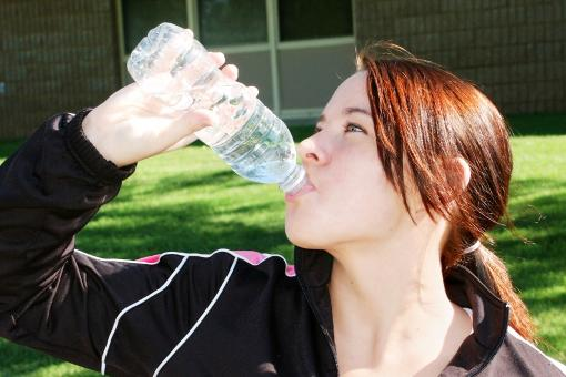 Girl drinking water - Free Stock Photo