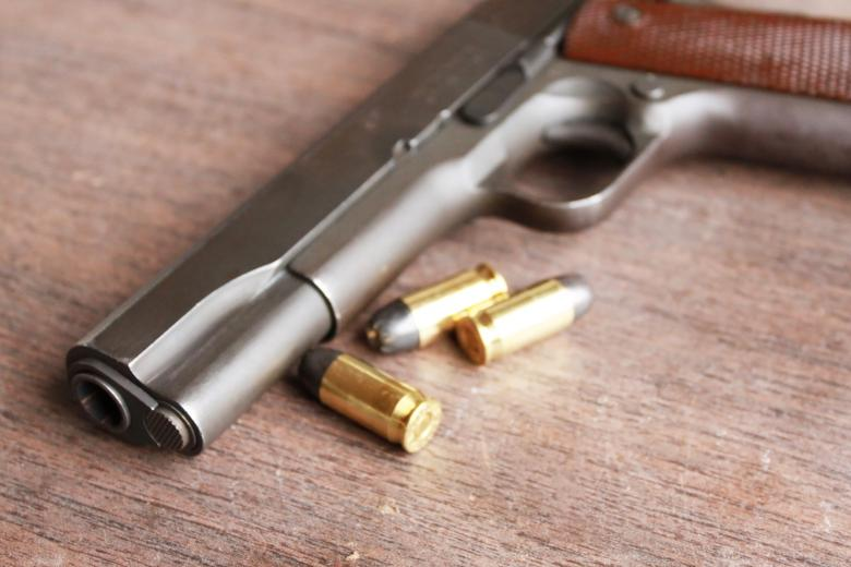 Free Stock Photo of Gun and bullets Created by Val Lawless