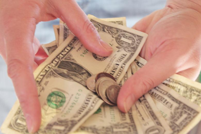 Free Stock Photo of Money in hands Created by Val Lawless