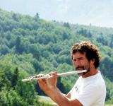 Free Photo - Man playing the flute in the mountains