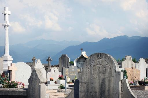 Graveyard and mountains - Free Stock Photo