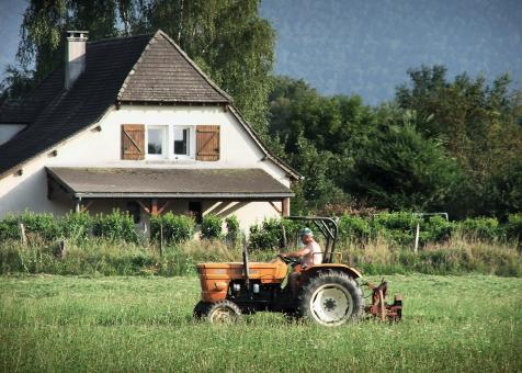 Farmer on tractor - Free Stock Photo