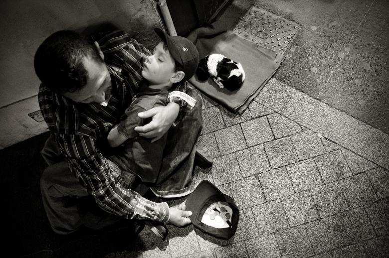 Homeless man with child and puppy - Free Urban Stock Photos
