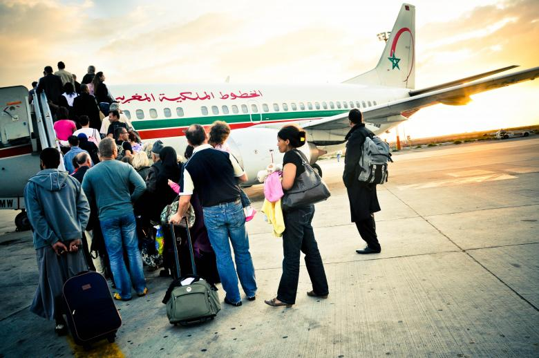 Free Stock Photo of Passenger boarding plane Created by Merelize