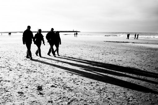 People walking on the beach - Free Stock Photo