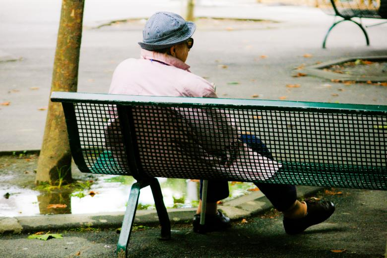 Free Stock Photo of Old woman sitting on bench Created by Merelize