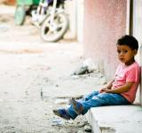 Free Photo - Sad little boy waiting outside