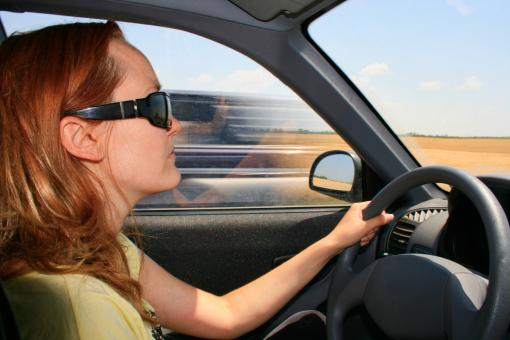 Woman driving a car - Free Stock Photo