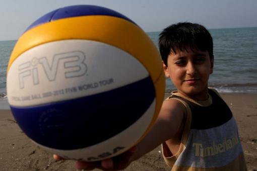 Boy holding a volleyball - Free Stock Photo