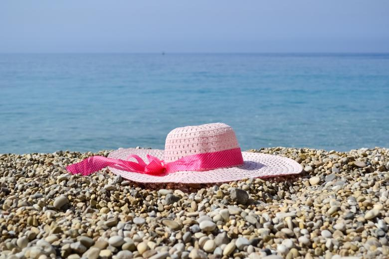 Free Stock Photo of Hat near the sea Created by Octavian