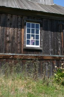 Little Girl in a Window in a Fort - Free Stock Photo