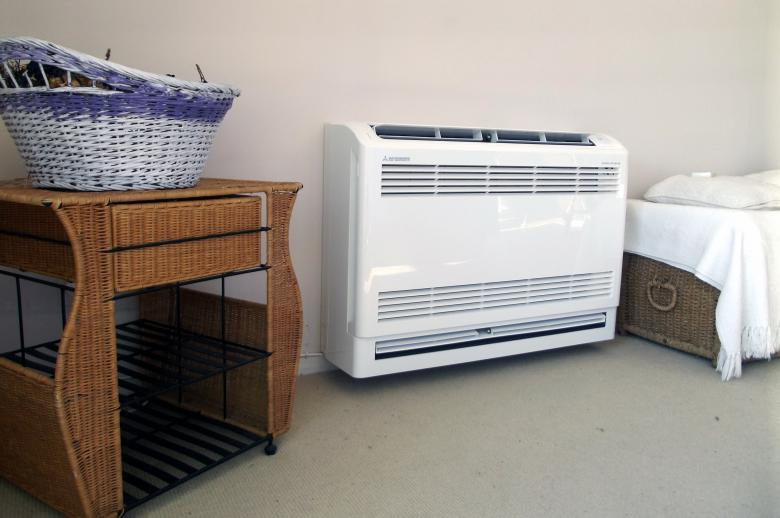 Free Stock Photo of Mitsubishi Floor Console Heat Pump Created by James Walton