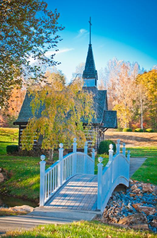 Free Stock Photo of Autumn chapel  across the bridge Created by agphotostock.com