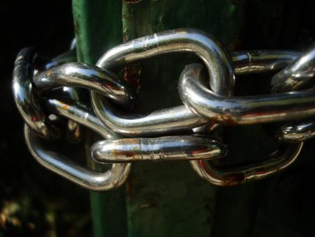 Chains on a metal door - Free Stock Photo