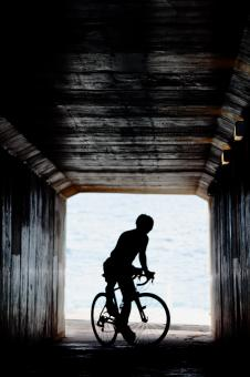 Cyclist in tunnel - Free Stock Photo