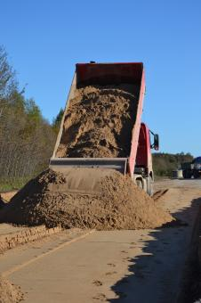 Sand pile and truck - Free Stock Photo