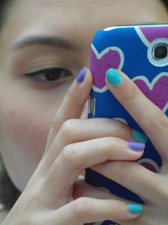 Free Stock Photo of Girl Using Touch Screen Phone Created by Ivan
