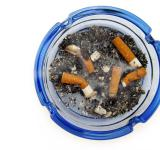 Free Photo - cigarettes in blue ashtray