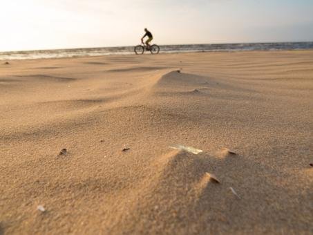 Cycling along the beach seaside - Free Stock Photo