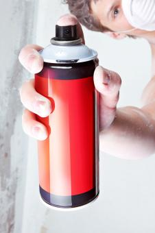 Spray can in hand - Free Stock Photo
